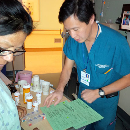 Pharmacist David Quan conducting a final MEDS review with Irene